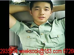 Chinese policeman in uniform jerking on back sit of car