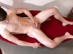 Skinny twink hotly wanks off his dick at front of the cam