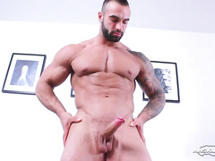 Amazingly strong young twink is hotly posing nude