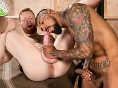 Tattooed hunk is making handsome gay to suck his dick