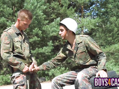 Soldiers are pleasuring passionate gay fuck at the post