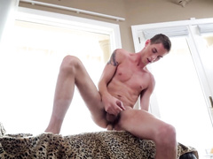 Slender young twink excitingly undressed and hotly masturbates
