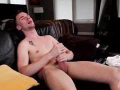 Short haircut young twink dude is sitting on couch and jerking off