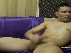 Gay's hand is giving fierce stroking to his cock